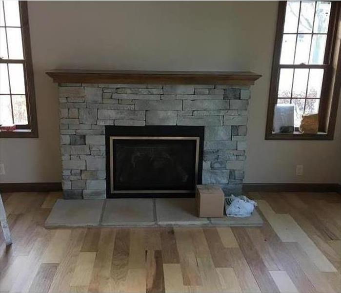Rebuilt fireplace with no signs of previous fire damage