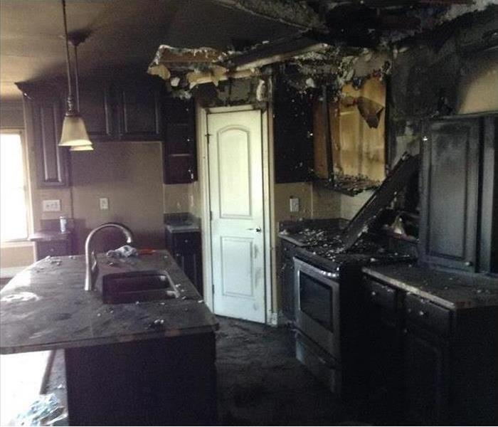 fire damaged cabinets, blackened counter top
