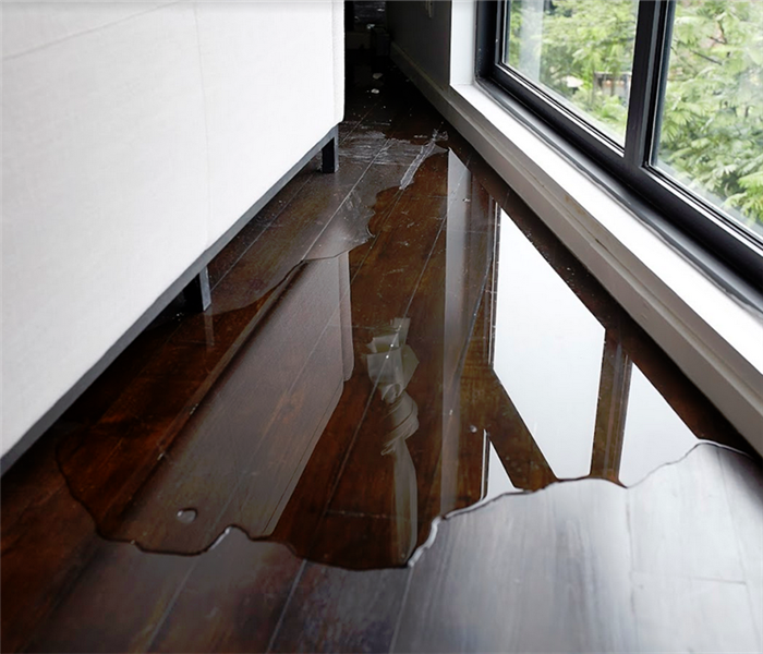 water flooding a wood floor in an apartment building