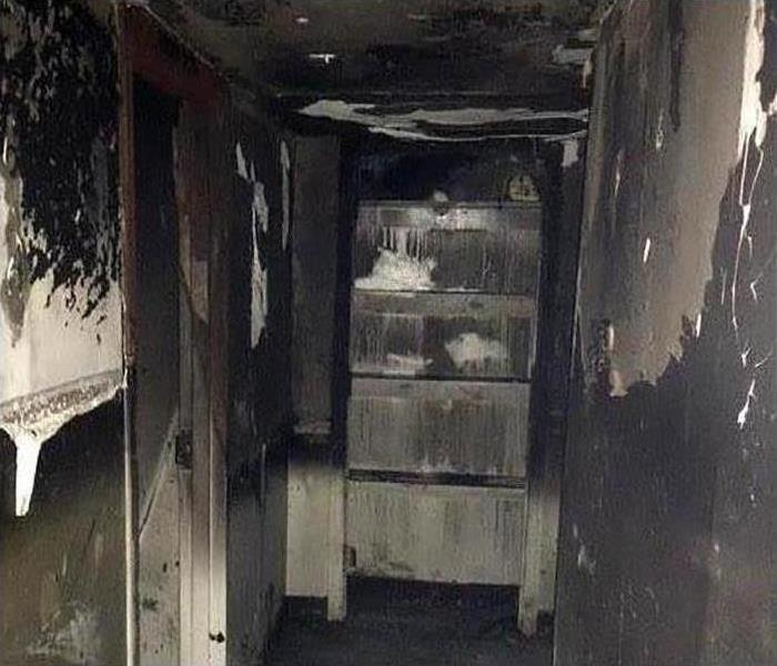 A room in this property covered in soot and smoke damage after a fire