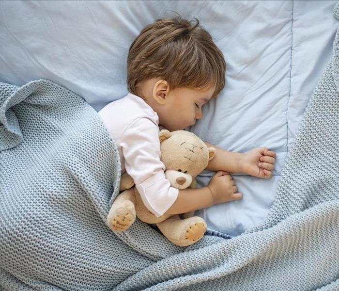 toddler sleeping with teddy bear